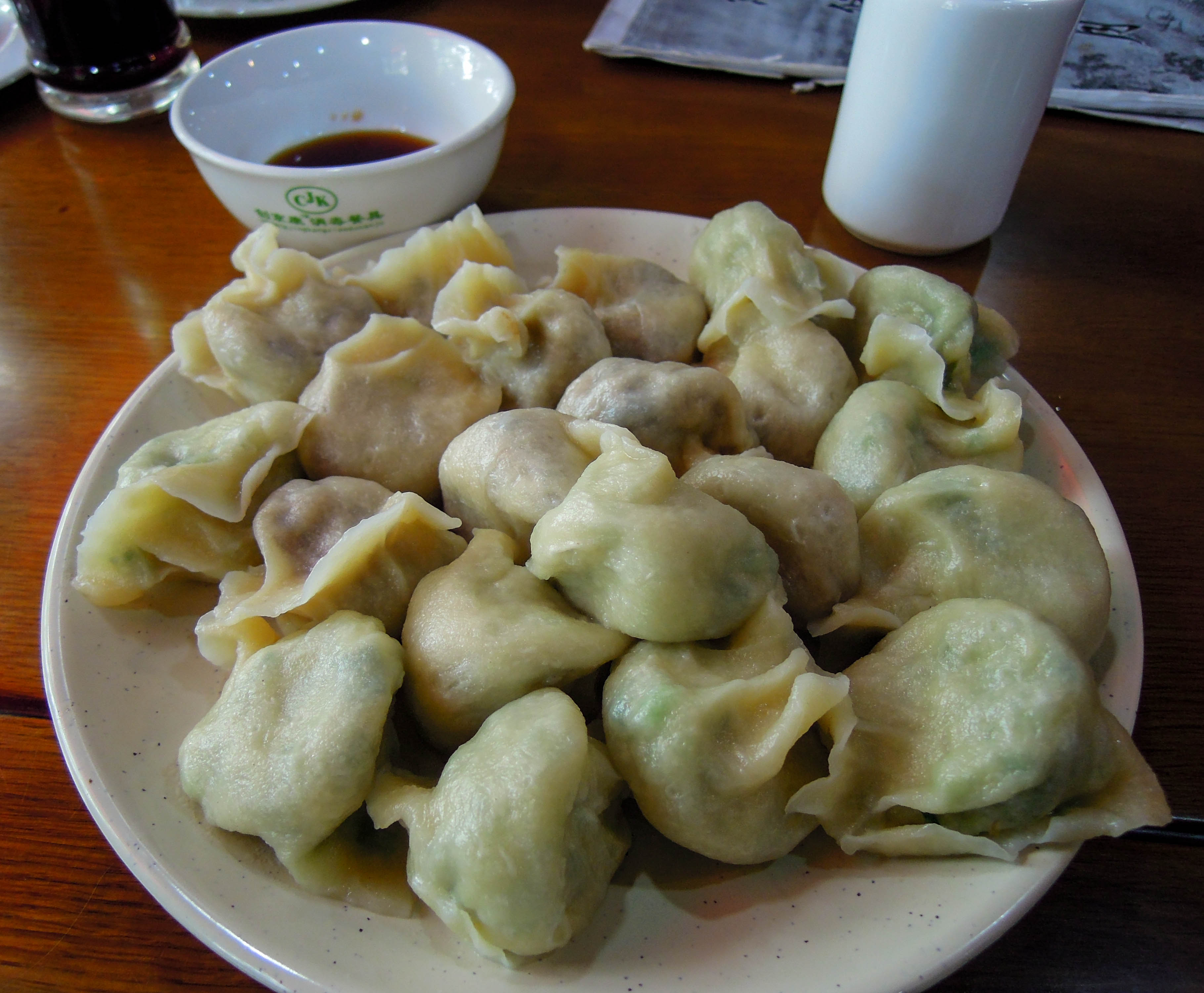 Dumplings china s traditional fast food into the middle for Academy of oriental cuisine