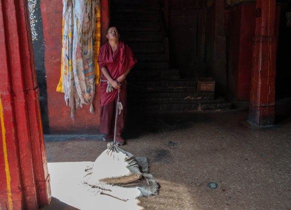 Polishing the floor. Shigatse, Tibet