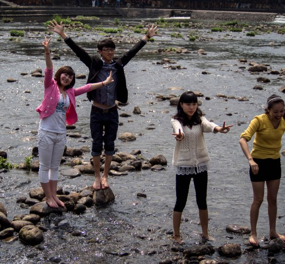 Chinese tourists getting their feet wet.
