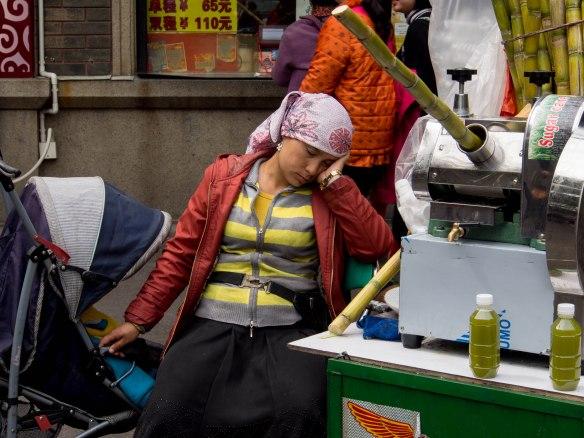 Sleeping sugar cane juice vendor.