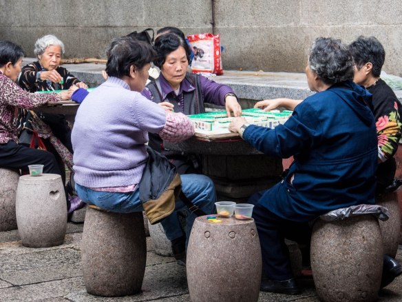 Retired women playing Mahjong