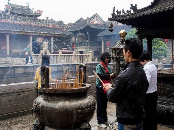 Worshippers burning incense