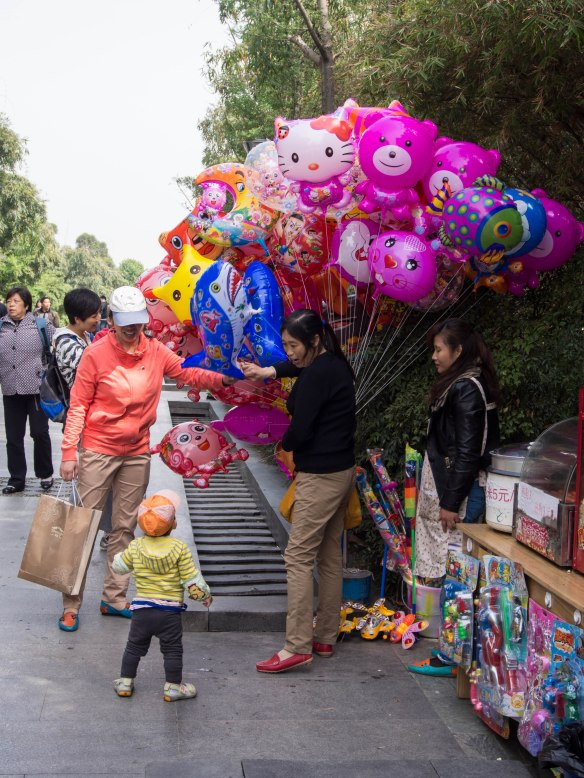 Balloon vendor along the Chinese stars path