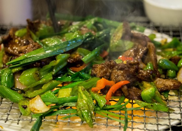 Tender beef and vegetables served over a flame.